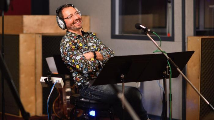 Alan Baylock, director, during recording session